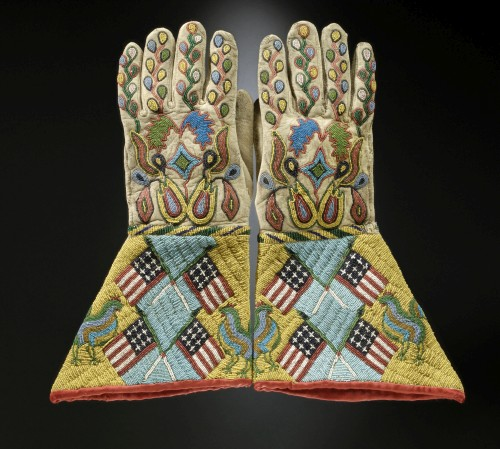 Gauntlets, c1890. Sioux-Métis artist, North or South Dakota. Native tanned leather, glass and brass beads, cotton cloth. 14 ½ x 8 in (36.8 x 20.3 cm). United States, Hirschfield Family Collection, Courtesy of Berte and Alan Hirschfield. Photograph: Hirschfield Family Collection, courtesy of Berte and Alan Hirschfield/ W. Garth Dowling. (Cat.94).