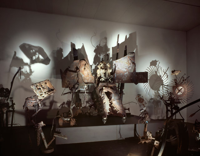 Jean Tinguely. Mengele-Totentanz (Hoch-Altar) with the four acolytes Bischof, Gemütlichkeit, Schnapsflasche and Television, 1986. Collection Museum Tinguely Basel - a cultural commitment of Roche. Photograph: Christian Baur, c/o Pictoright Amsterdam, 2016.