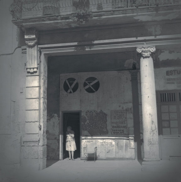 Alexey Titarenko. Woman in Doorway, Havana, 2003. Gelatin silver print, printed by the artist, edition 1/5, 10 3/4 x 10 7/8 in (27.3 x 27.6 cm).