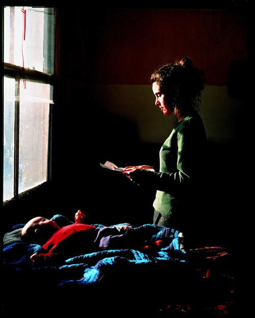 Tom Hunter (born 1965). <em>Woman reading a Possession Order</em> 1997. Courtesy the artist and Jay Jopling/White Cube, London © Courtesy the artist and Jay Jopling/White Cube, London. From: Tom Hunter: Living in Hell and Other Stories, 7 December 2005-12 April 2006. National Gallery, London.