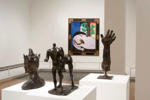 Transfigurations (installation view). Picasso's painting Nu au fauteuil noir and sculptures Le bras, Le centaure and Le Fou. Courtesy of the Wexner Center.