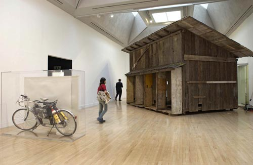 Simon Starling.<em> Shedboatshed</em> <em>(Mobile Architecture No.2)</em>, 2005. Mixed media Kunstmuseum Basel. <em>Tabernas Desert Run,</em> 2004. Fuel cell powered bicycle, watercolour and Perspex vitrine Glasgow City Council (Museums), Gallery of Modern Art, bought with the assistance of the National Art Collections Fund.