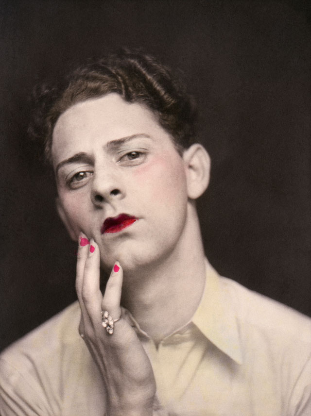 Man in makeup wearing ring. Photograph from a photo booth, with highlights of colour. United States, c1920. © Sébastien Lifshitz Collection. Courtesy of Sébastien Lifshitz and The Photographers' Gallery.