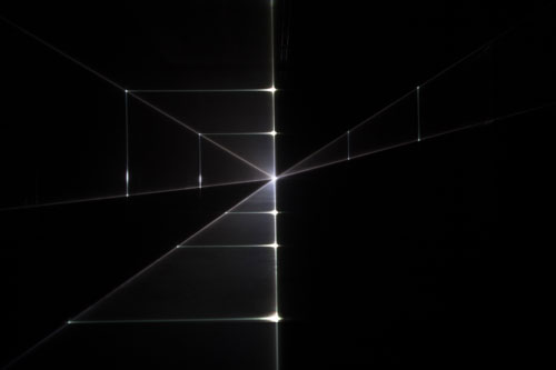 United Visual Artists: Vanishing Point. Installation view (1), 2013. RGB laser, black voile, code. Photo courtesy of the artists.