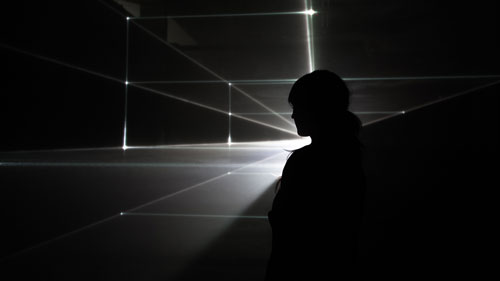 United Visual Artists: Vanishing Point. Installation view (2), 2013. RGB laser, black voile, code. Photo courtesy of the artists.