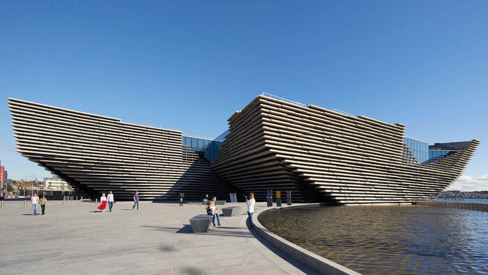 Kengo Kuma has delivered a new landmark in the V&A Dundee. It is a craggy sculptural structure inspired by the city's shipbuilding past and Scotland's rugged cliffs, which Kuma hopes will reconnect the city with nature. Inside, he has crafted an interior of warmth and welcome. But has he delivered a 'living room for the city?'