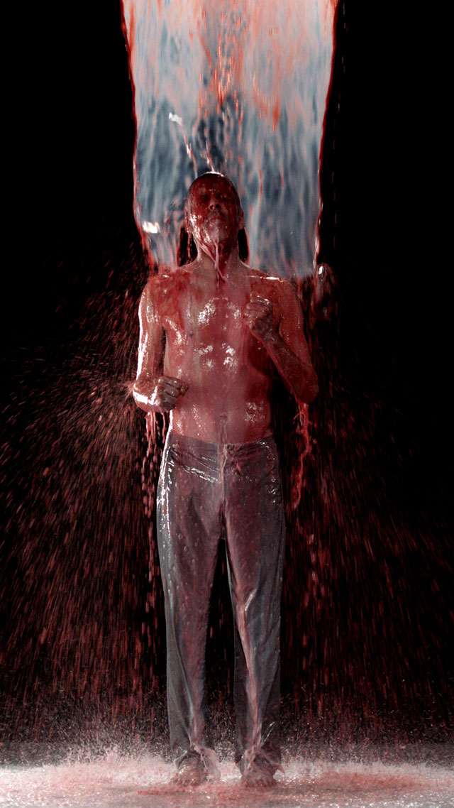 Bill Viola. Inverted Birth, 2014. Video/sound installation. Colour high-definition video projection on screen mounted vertically and anchored to floor in dark room; stereo sound with subwoofer, projected image size: 16 ft 5 in x 9 ft 3 in (5 x 2.82 m), 8:22 minutes. Performer: Norman Scott.