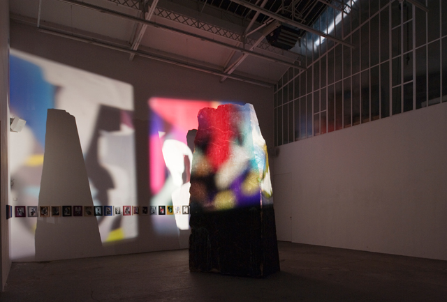 Nico Vascellari. I Hear a Shadow, 2009-11. Bronze, iron, acids, three slide projections (160 slides), sound system, variable dimensions (monolith 430 x 210 x 117 cm). Installation view, Galerie Bugada & Cargnel.