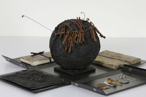 Ricardo Brey. Black box, 2009. Metallic paint, paper, glass teardrops, glass, mica, metal, black sand, rope, wire, keys, bells, one leporello book, one notebook, untitled leporello book, notebook nineteenth-century metaphysical treatise, dimensions variable. Courtesy the Artist; Galerie Nathalie Obadia, Paris/Brussels. Photo Dirk Pauwels, Ghent. 56th International Art Exhibition - la Biennale di Venezia, All the World's Futures. Photograph: Alessandra Chemollo. Courtesy by la Biennale di Venezia.