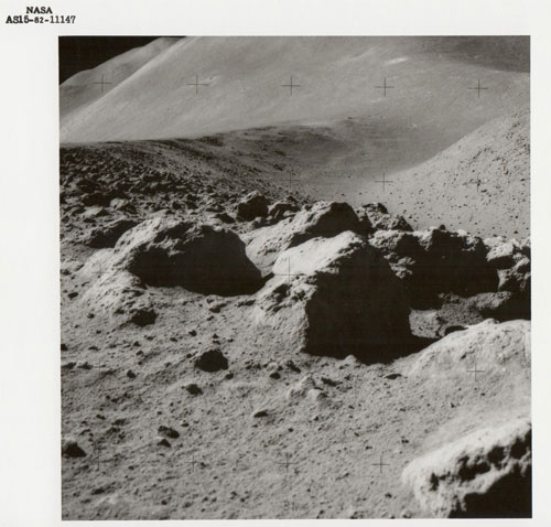 Lunar boulders, St George Crater beyond, Apollo 15, July 1971, Vintage gelatin silver print, c20 x 25cm, NASA AS15-82-11147. Courtesy Breese Little.