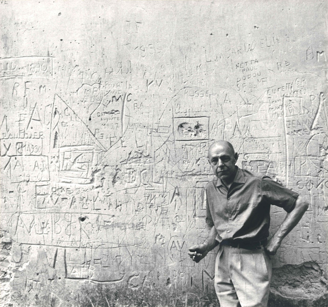 Jean Dubuffet in front of a graffiti wall, Vence, 1959 © Archives Fondation Dubuffet, Paris. Photo: John Craven.