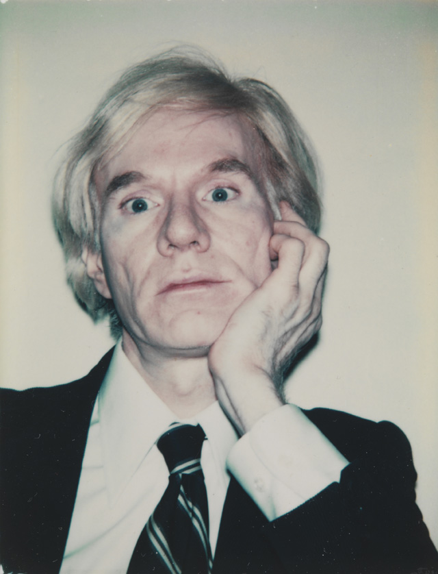 Andy Warhol. Self-Portrait in Dark Suit, 1986. Photograph, colour, Polaroid, on paper, 9.4 x 7.2 cm. ARTIST ROOMS National Galleries of Scotland and Tate. Acquired jointly through The d'Offay Donation with assistance from the National Heritage Memorial Fund and the Art Fund 2008. © 2018 The Andy Warhol Foundation for the Visual Arts, Inc. / Licensed by DACS, London. 2018