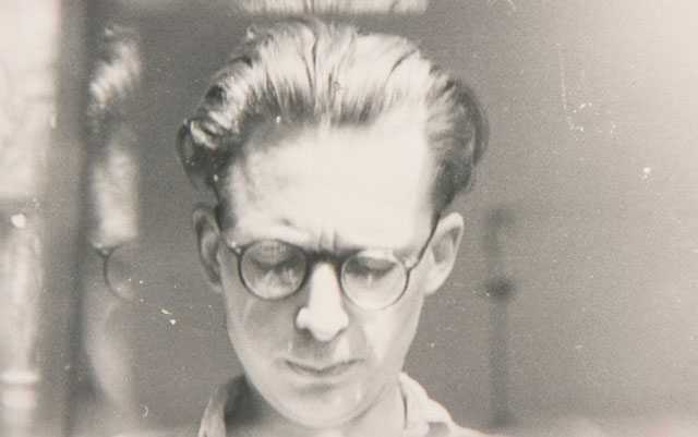 Andrzej Wróblewski, [Self-Portrait with Glass Reflection], undated. Black and white photograph, 5.2 x 8.4 cm. Archive of the Artist's Heirs. © Andrzej Wróblewski Foundation.