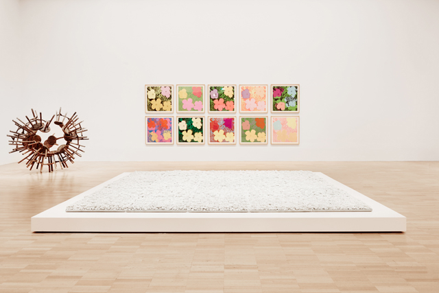 Installation view of the Andy Warhol | Ai Weiwei exhibition (foreground: Ai Weiwei, Blossom, 2015) at the National Gallery of Victoria, 11 December 2015 – 24 April 2016. Andy Warhol artwork © 2015 The Andy Warhol Foundation for the Visual Arts, Inc./ARS, New York. Administered by Viscopy, Sydney; Ai Weiwei artwork © Ai Weiwei. Photograph: Brooke Holm.