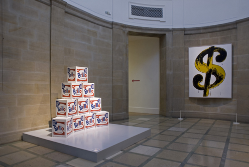 Andy Warhol. <em>Brillo Boxes</em> (1968) and <em>Dollar Sign</em> (1982).