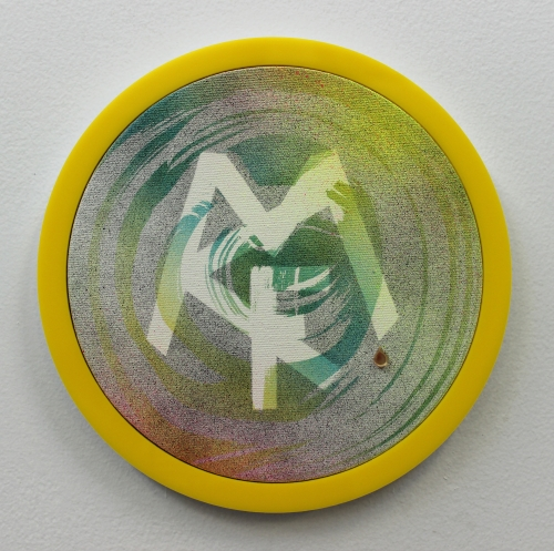 Wendy White. MCF II, 2014. Acrylic on canvas, plexiglas and PVC frame, gold, mirror, 9 in diameter.