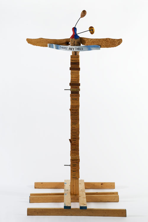 Jimmie Durham. Choose Any Three, 1989. Carved and painted wood, metal, and glass, 99 3/16 x 49 3/16 x 48 in (251.9 x 124.9 x 121.9 cm). Kurimanzutto, Mexico City. Courtesy the artist and kurimanzutto, Mexico City. Copyright Jimmie Durham. Photograph: Jean Christophe Lett.