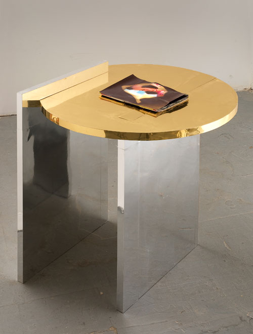 Alice Könitz. Magazine Table, 2008. Wood, metallic paper and inkjet prints, 32 x 33 x 32 in (81.3 x 83.8 x 81.3 cm). Collection of the artist. Courtesy Susanne Vielmetter, Los Angeles Projects, Los Angeles .