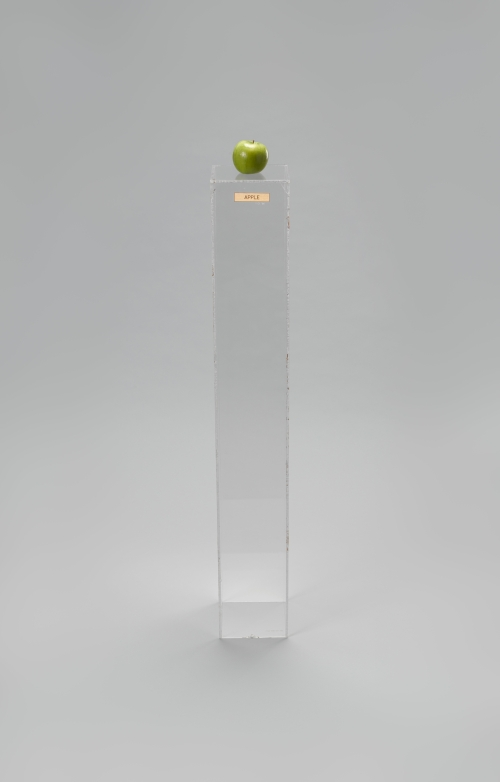 Yoko Ono. Apple, 1966. Plexiglas pedestal, brass plaque, apple, 45 × 6 11/16 × 6 15/16 in (114.3 × 17 × 17.6 cm). Private collection. © Yoko Ono 2014.