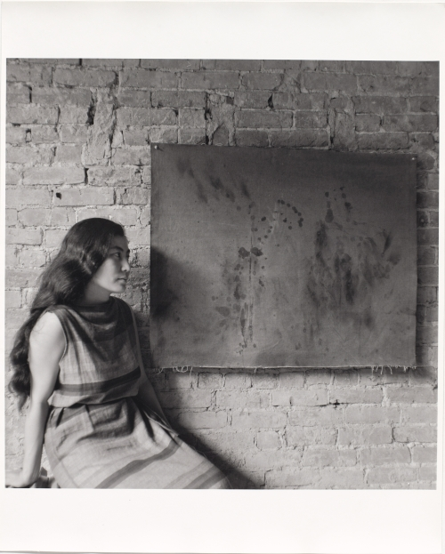 Painting to See in the Dark (Version 1), 1961. Installation view with the artist, Paintings & Drawings by Yoko Ono, AG Gallery, New York, July 17–30, 1961. Photograph: George Maciunas. The Museum of Modern Art, New York. The Gilbert and Lila Silverman Fluxus Collection Gift, 2008. © 2014 George Maciunas.