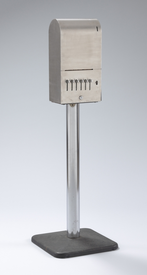 Yoko Ono. Sky Machine, 1961/1966. Stainless steel dispenser, metal pedestal and handwritten cards. Dispenser: 51 3/16 x 16 1/8 x 16 1/8 in (130 x 41 x 41 cm); card (each): 1 x 1 3/4 in (2.5 x 4.5 cm). The Museum of Modern Art, New York. The Gilbert and Lila Silverman Fluxus Collection Gift, 2008. © Yoko Ono 2014.