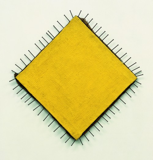 Günther Uecker. The Yellow Picture (Das gelbe Bild), 1957–58. Nails and oil on canvas, 87 x 85 cm. Private collection. © Günther Uecker. Photograph: Nic Tenwiggenhorn.