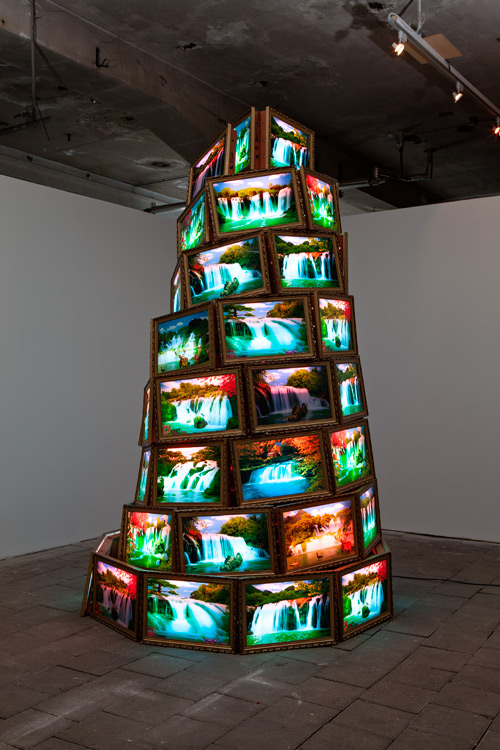Goran Hassanpour. Tower of Babel, 2011. Three metres high tower made out of light-boxes. Photograph: Vegard Kleven.